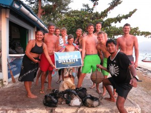 Happy divers helping the environment