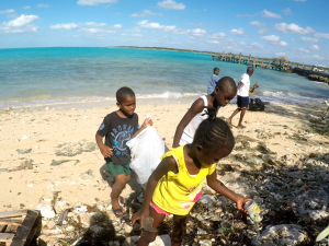 clean up beach in Bahamas All For Blue