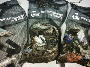 Divers filled their Project AWARE mesh bags