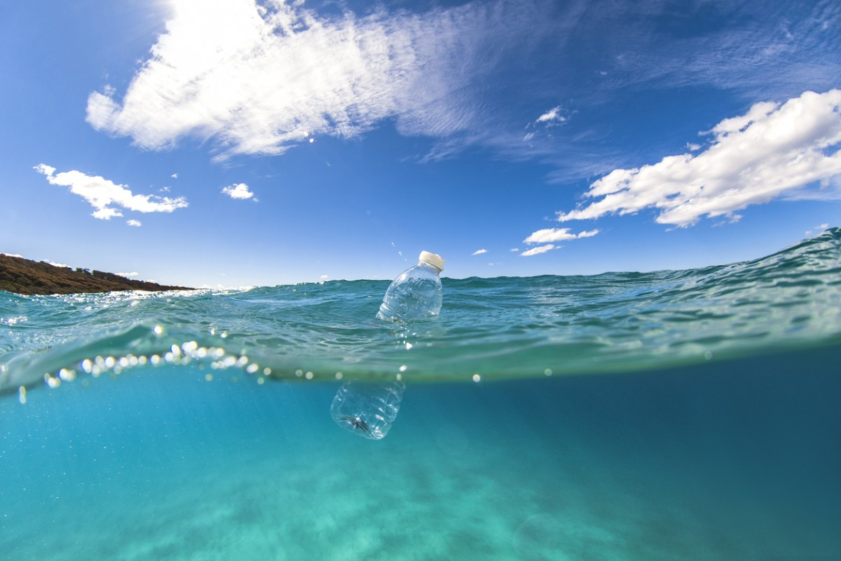 Plastic bottle floats in ocean: lindsay_imagery Project AWARE
