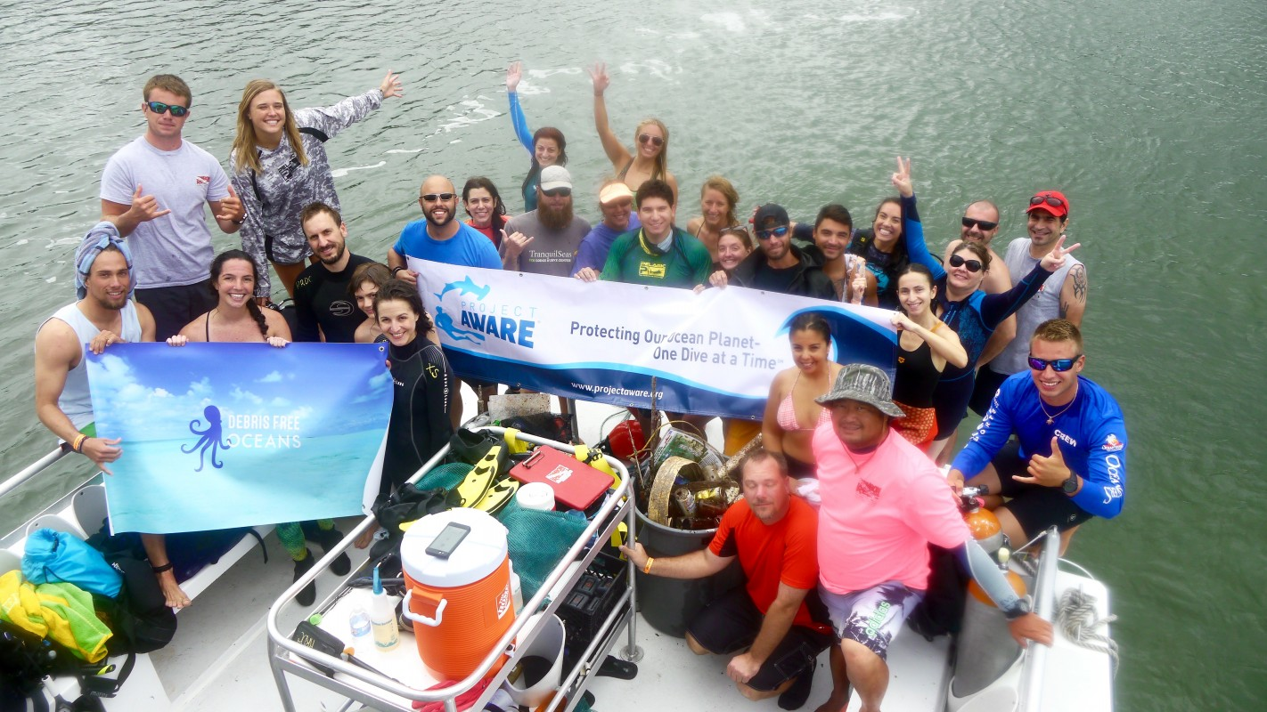 image of Project AWARE team on a boat
