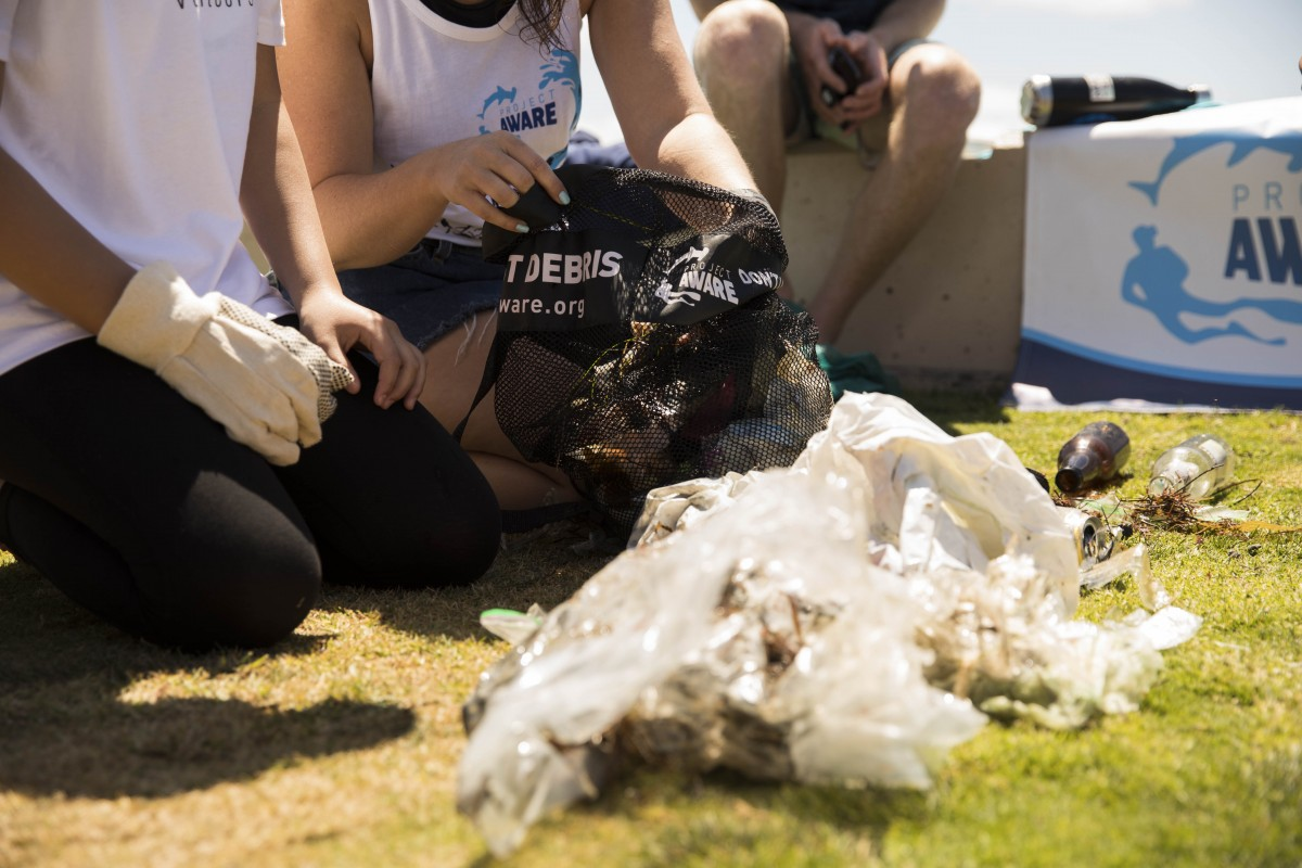 image of Project AWARE team sorting debris