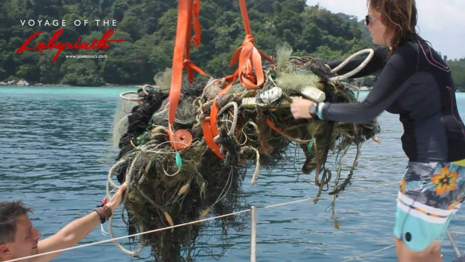 Image of divers removing a ghost net and other debris