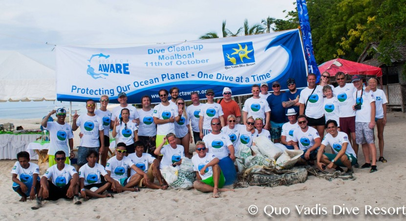 Happy volunteers on the beach after picking up 118 kg of trash from the ocean bed