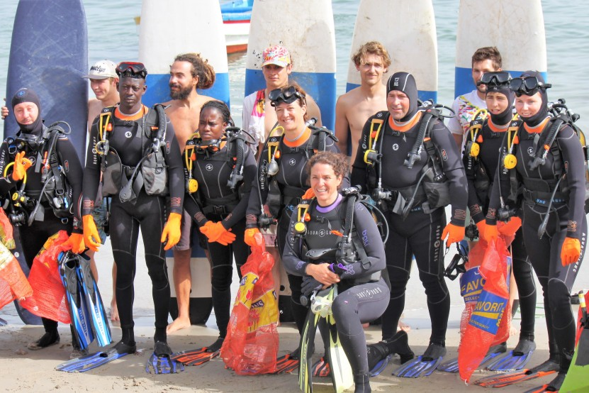 Scuba divers and surfer team