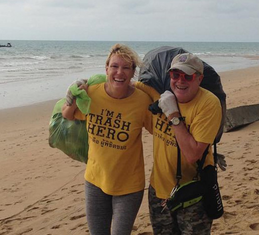 Collecting trash on a beach clean up.
