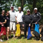Seven volunteer divers line up for a group photo after the cleanup!