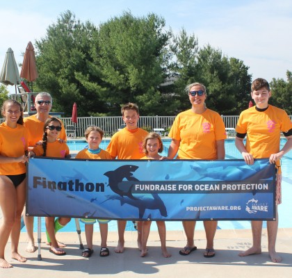 Image of Finathon® fundraisers with a banner